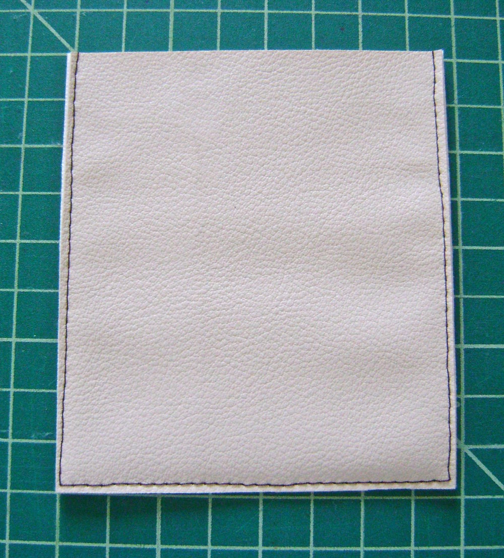 "step 7 -  Clasp Flap   With wrong sides together stitch three sides .25"" from the raw edge.  Cut close to stitching to create a tiny clean edge."