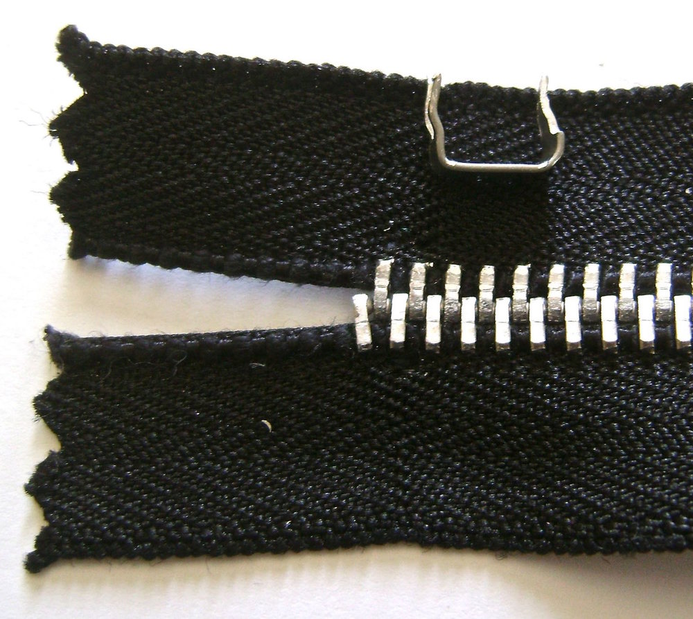 step 5 -  Front Zippered Pockets  Cut along the pocket zipper line on both pocket pieces.   If you are attaching special zipper pulls, remove the metal tab at the bottom of the zippers as well as the existing zipper pull. If you are using the zippers as they are, skip step #6.