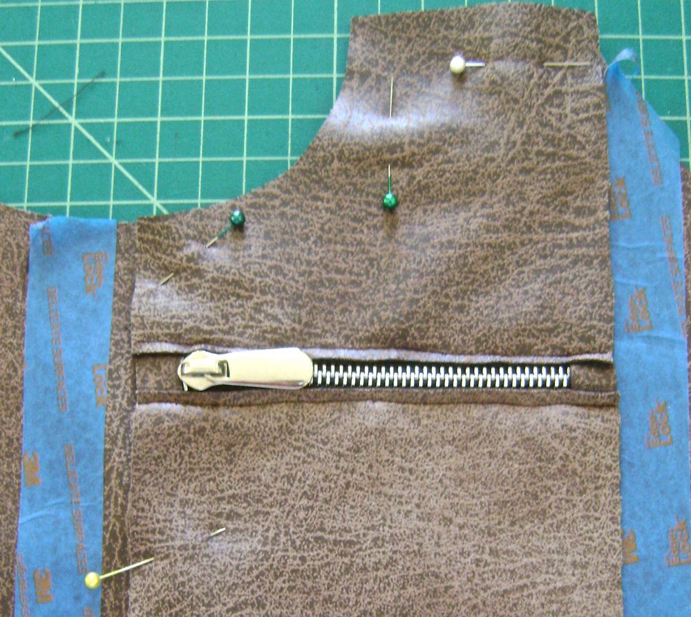 "step 11 - Align zippered pocket pieces to bag at top edge with pocket sides 2.75"" from bag sides.  There should be approximately 5/8"" space in the center between the two zippered pockets."