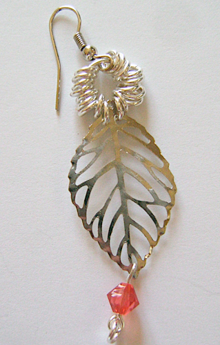 step 9 - Attach the loop in the bead wire to the bottom opening in the leave. Make four more bead wires and attach them along the leaf openings with two on the left and two on the right.
