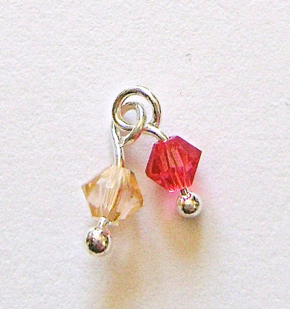 step 2 - Open the loop of a peach bead and insert it into the loop of a rose bead.  Create ten of these pairs.