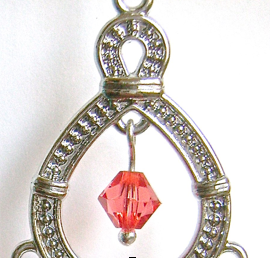 step 6 -  Open the loop in the 6mm rose bead and attach it to the top inside center of the teardrop.
