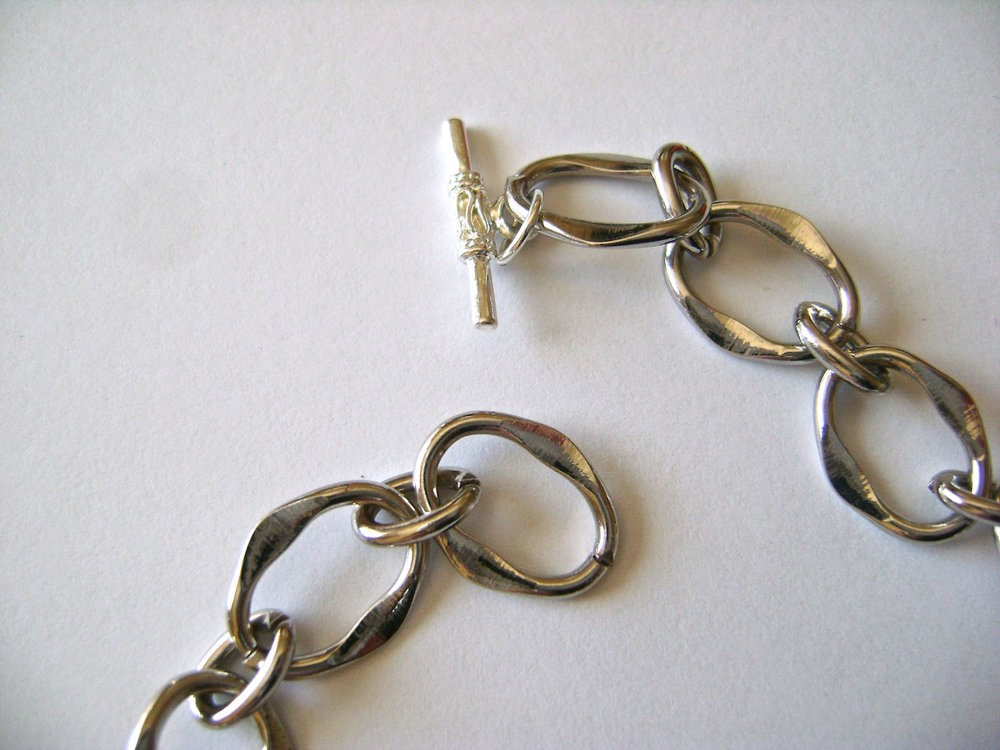 step 7 - Complete the necklace by connecting a toggle clasp to the end of the chain with a jump ring.