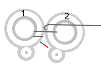 step 2 - Add a second ring. Pass the wire across the top of ring 2, then to the back. Come up between the two rings with the wire across ring 2.