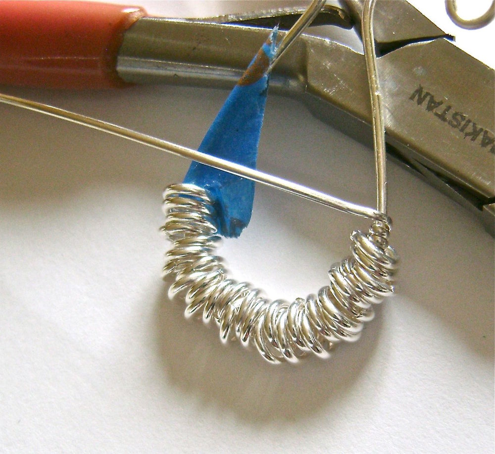 "step 5 - Cut a piece of half round wire to measure 16"".  Wrap the end around the untaped round wire twice.  Bring the wire to the front of the work."
