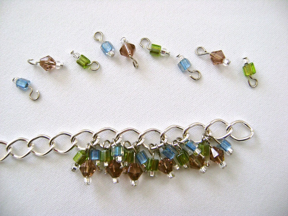 step 4 - Attach the 3 bead set onto the chain link in order by color.  Close each loop.