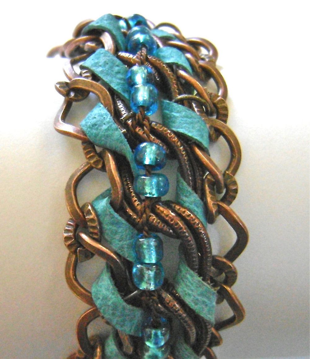 "bracelet measures 7"" long, 1"" wide"
