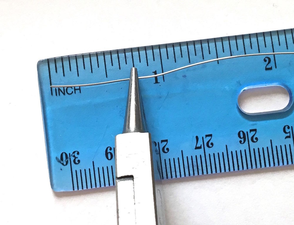 "step 4 - Cut 11 pieces of 26 gauge wire to measure 3"" long.  Grip the end of a wire at .75"" with needle nose pliers."