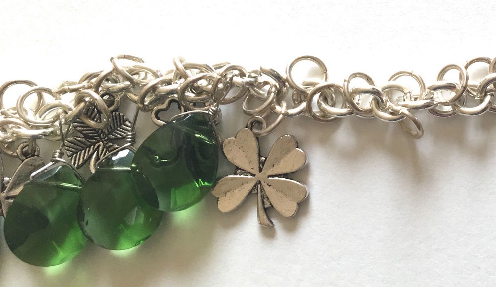 step 11 - Open the chain links between the charms and attach the beads.