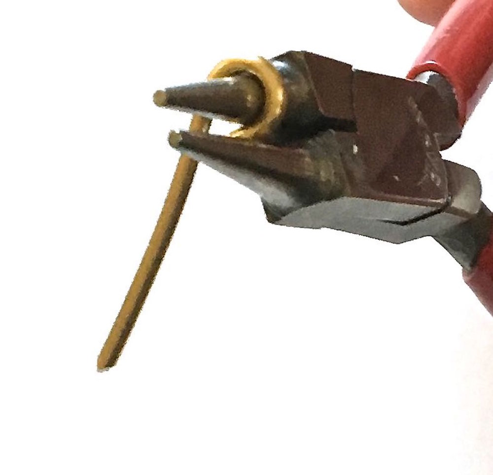 "step - Cut ten pieces of 14 gauge wire to measure 1.50"". Using the widest section of round nose pliers, curl one end of the wire until it meets the straight end."