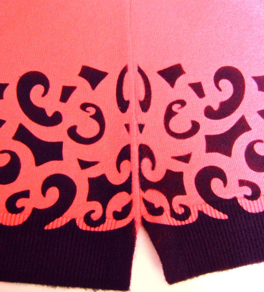 step 9 - If the painted design did not reach far enough to the sides of the sweater, position a portion of the stencil over the area to fill it in. As an option, you can also stretch the page before printing it so the stencil is closer to the width you need. If you find less than perfectly crisp lines on some of the painted areas, touch them up using a fine paint brush.
