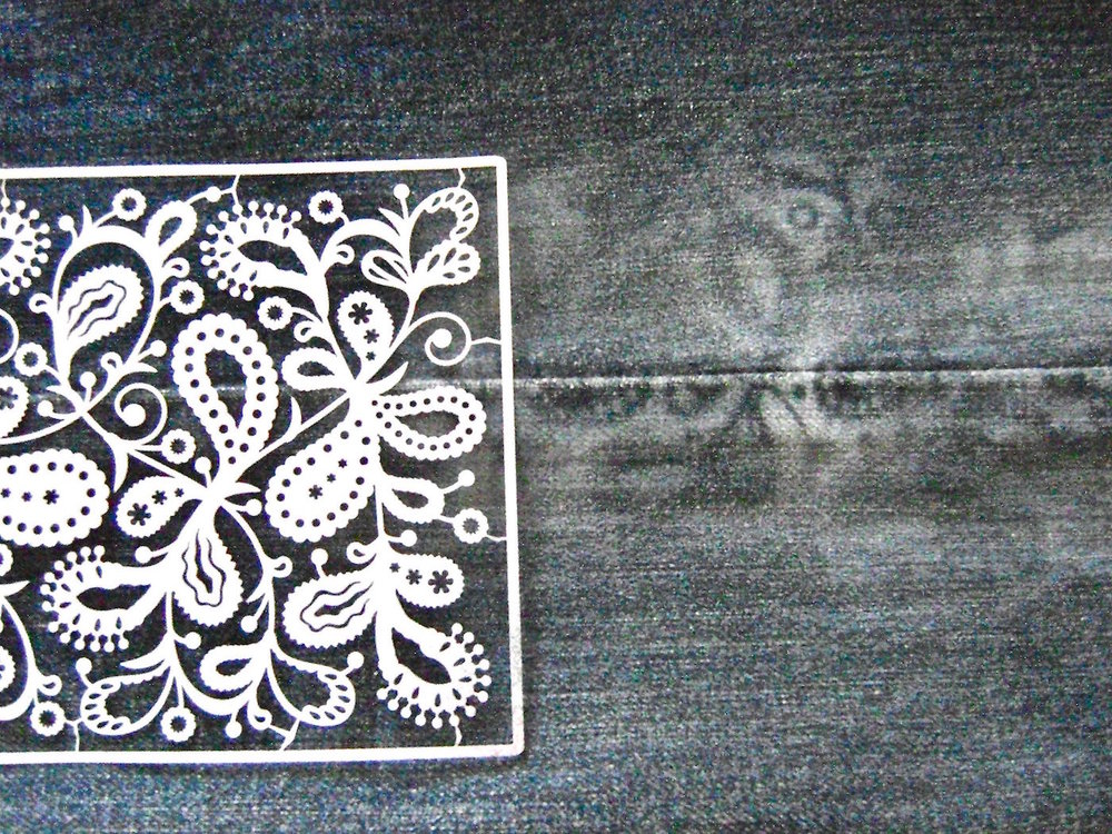 step 3 - Place the paisley stencil on the jeans, matching the middle of the stencil with the side seam of the jeans.