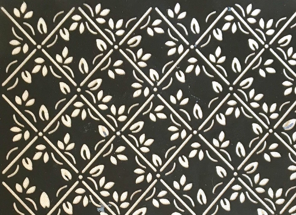 The purchased decorative stencil has a lattice and leaf theme. It's made by Plaid.