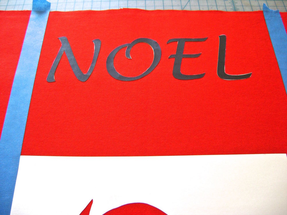 step 8 - Remove the Noel stencil, without disturbing the four letters.