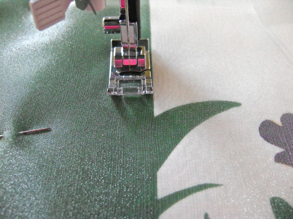 "step 11 - Sew the organza to the pillow front by stitching .25"" from the vertical green edge."