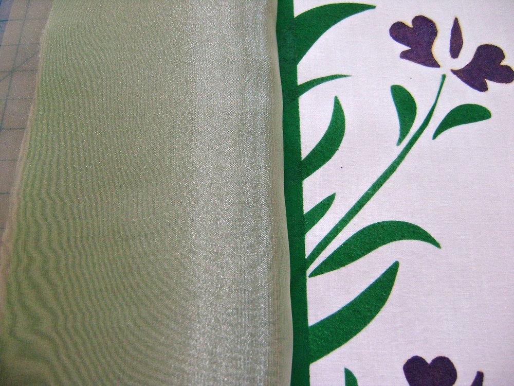 step 12 - Bring the right side of the organza over the left, creating a two layer cover over the green paint.  Press the seam flat and pin all layers together.