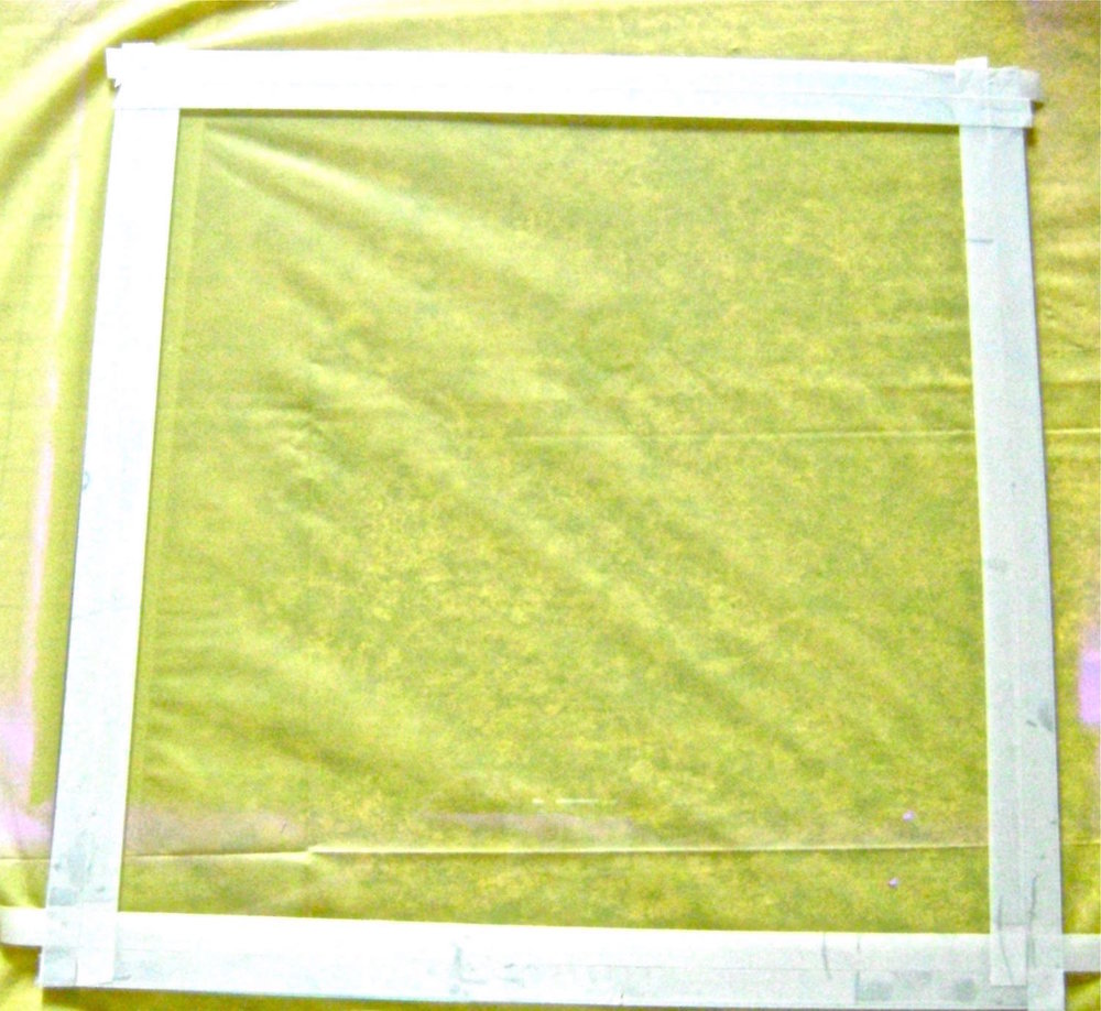 step 5 - Place a strip of half-inch masking tape along the edges of the glass on all four sides, aligning the edge of the tape with the outer edge of the glass.