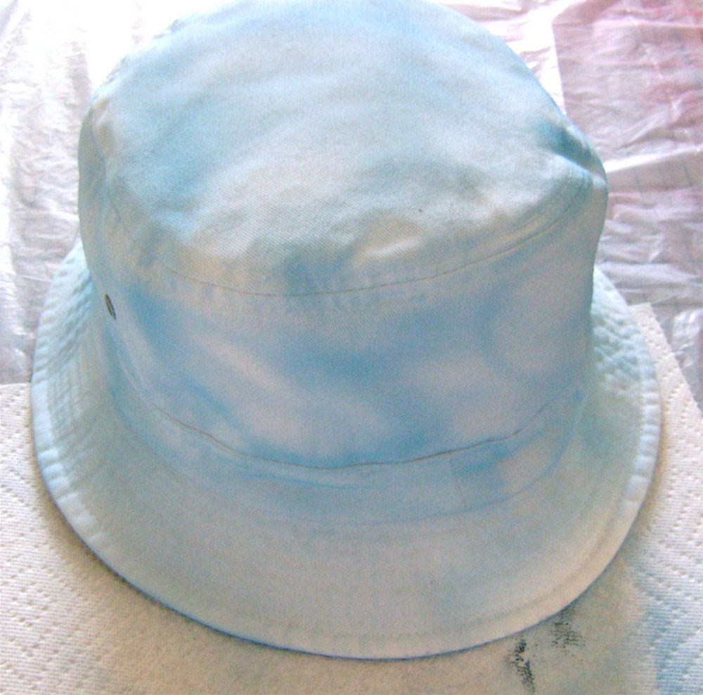 step 9 - Paint the exterior of the hat with light blue paint in random patterns.