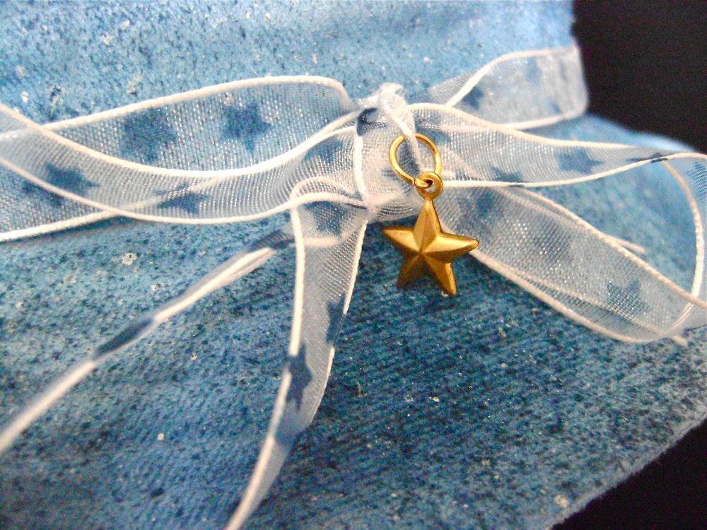 step 14 - Tie the ribbon around the hat and into a bow.   Attach the brass star charm to the ribbon with a jump ring.