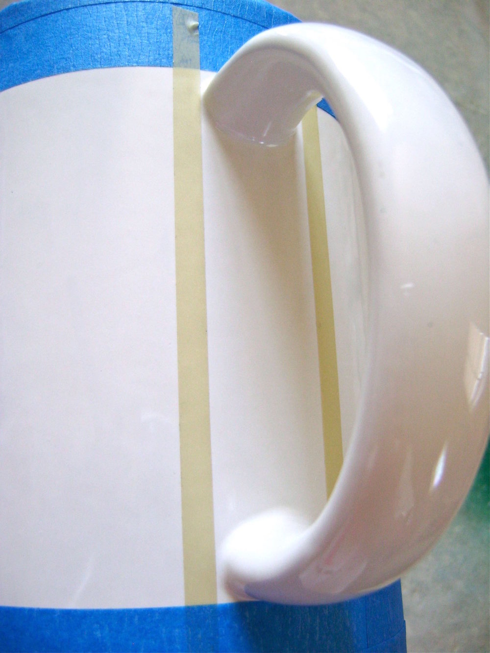 "step 3 - Place ¼"" masking tape vertically on both sides of the handle."