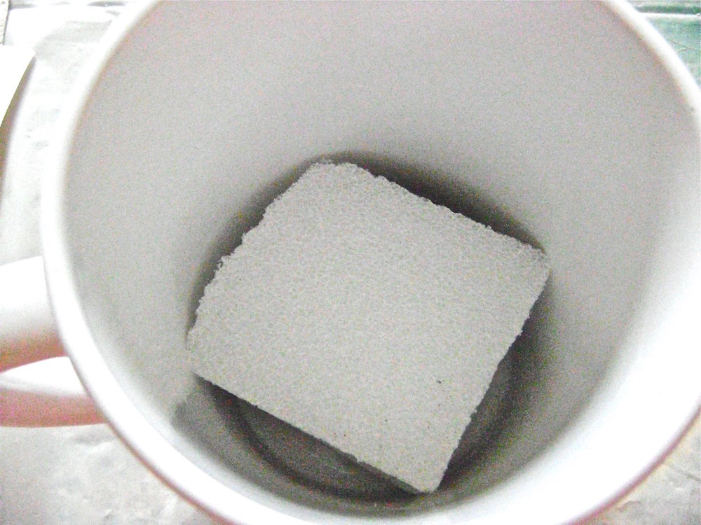 step 11 - Cut a piece of Styrofoam to fit snugly into the mug.  Hot glue the foam to the bottom.