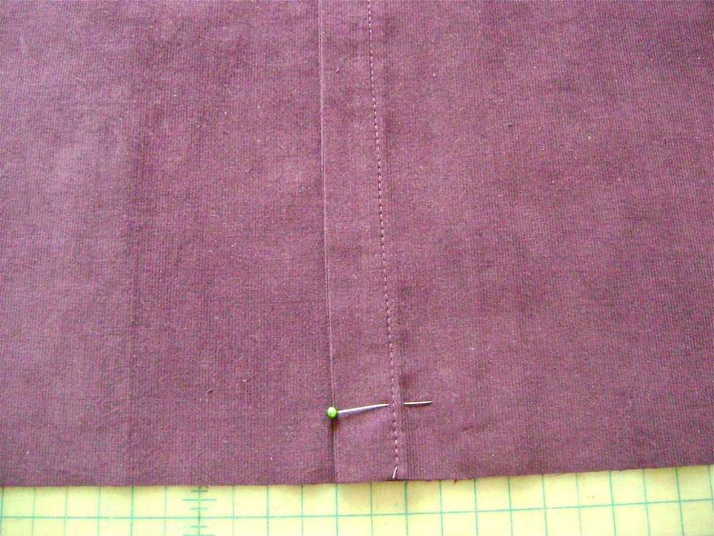 "step 17 - Overlap the two pieces so that they measure 17"" across.  There should be approximately 3"" of overlap.  The 8.5"" piece should be on top.  Stitch on the existing hemline one inch in from the raw edge on both ends of the opening."