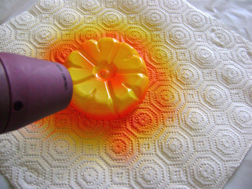 step 4 - Use a heat gun to shape the flowers.   It works very quickly. Heating in short bursts close to the plastic will give you more control of the curling.  Experiment beforehand on unpainted plastic to get a feel for how it will react to heat.