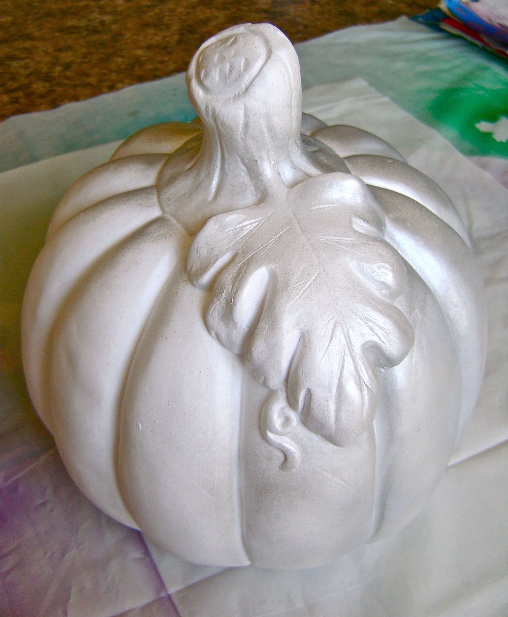 step 2 - On a protected surface, airbrush the pumpkin with silver paint.