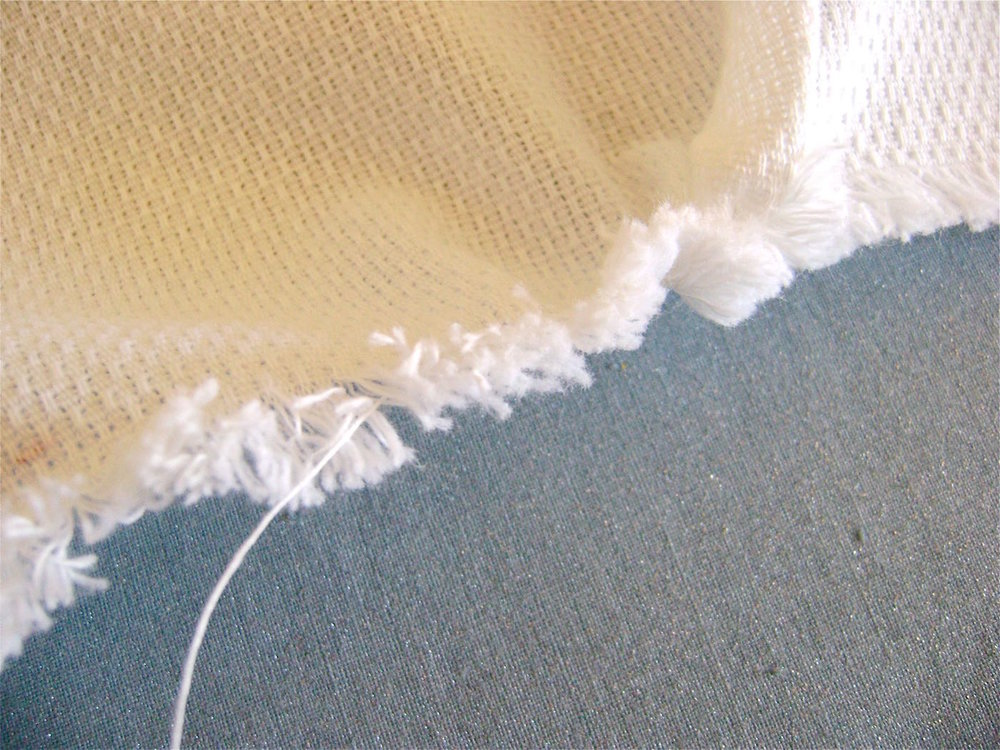 step 3 - If you have a problem pulling a thread, it's usually because another thread is blocking it somewhere along the width.  Use the pin to find it, pulling at threads along the edge.