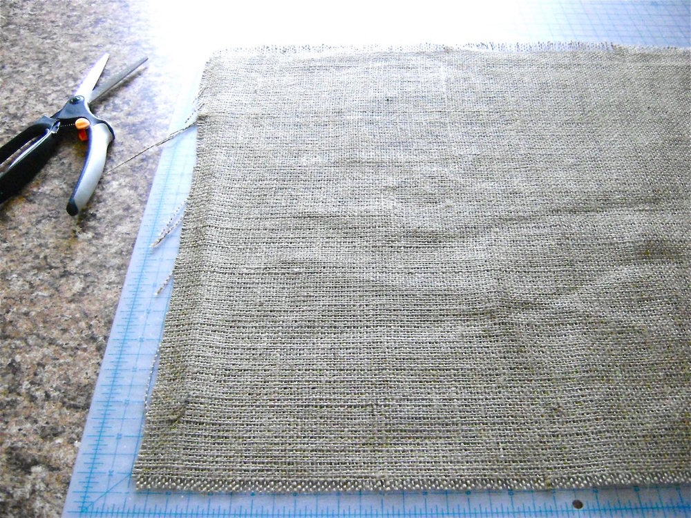 "step 6 - Measure 18 ½"" from the edge of the fringe and cut away the excess burlap.  Remove threads to create a half-inch fringe along the second vertical side."
