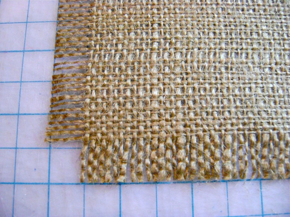 "step 7 - Once both vertical edges are fringed, create a half-inch of fringe on one end of the runner.  From the edge of that fringe, measure 6' 14"" and cut the other end.  Fringe the end to measure a half-inch."