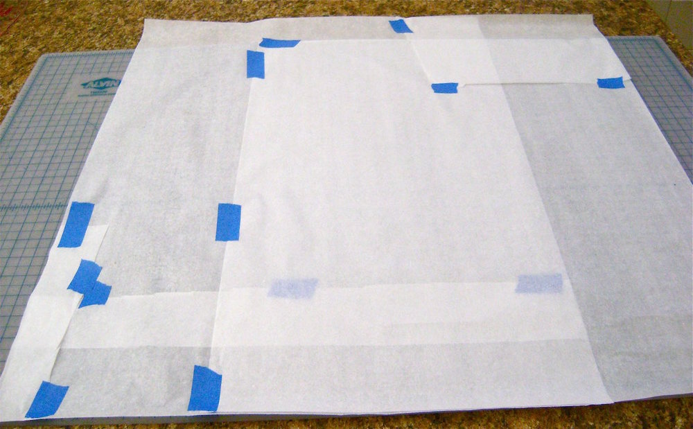 "step 1 -  The Pattern   Create a 27"" square from gift-wrap tissue paper or other handy materials.  Piece the paper together with painters tape."