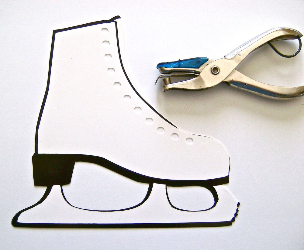 "step 1 -  THE SKATE   Download and print out the skate image on glossy photo paper or card stock.   Glue the paper to a sheet of plain card stock, which will give the skate more support.  Position the glue close to cut lines so glue will remain after the skate has been cut out.  When the glue is dry, use a craft knife or scissors to cut out the skate.  Punch 11 holes in the skate ¼"" apart as shown."