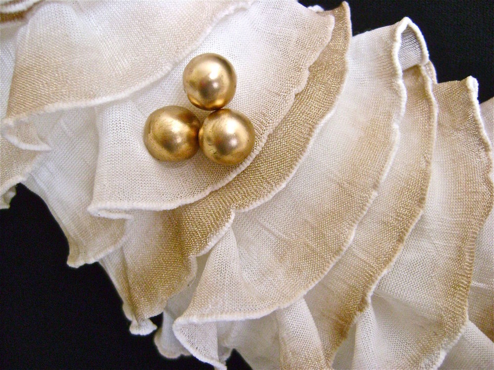step 13 - Cut a few gold ball stems and poke them into the wreath in clusters.   Dab the stem wires with hot glue before poking them through the fabric and into the Styrofoam.