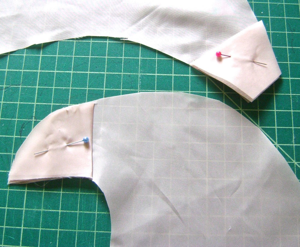 "step 3 - Trace the fabric ends onto folded pieces of scraps to create facings for the top and bottom ends. They should be 2.50"" deep. Iron one layer of sturdy fusible interfacing inside the folded facings. This will give added strength and support especially for the top eyelet to be attached in step 6."