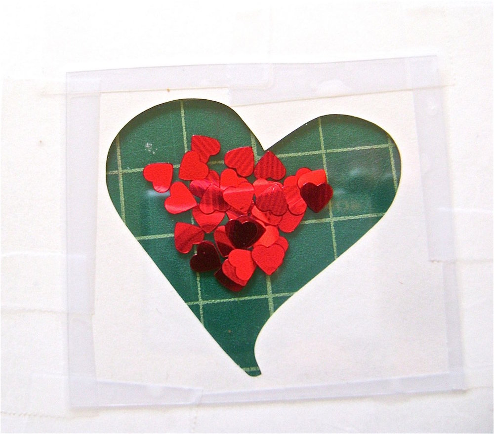 step 4 -  Loosely place a group of hearts in the center of the plastic.