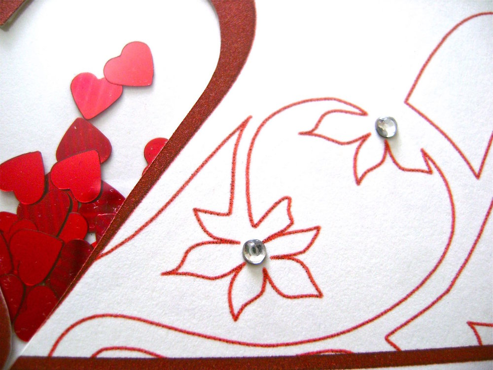 step 6 - Fold the card in half.  Glue rhinestones to the centers of the flowers.