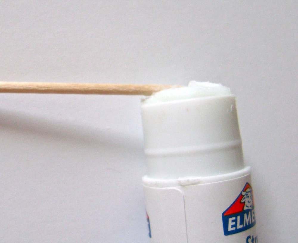 step 6 - To create the flowers, roll the top of a toothpick across the flat surface of an Elmer's Extra Strength glue stick.