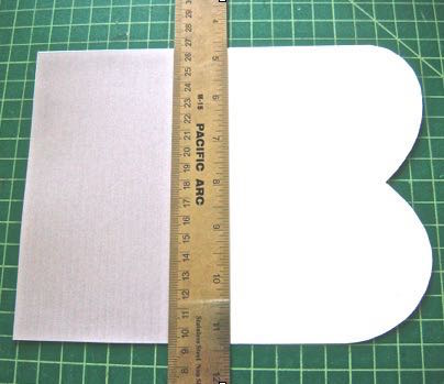 step 5 - Place a ruler on the top edge of the liner and fold the curved side of the template over it.  Remove the ruler and create a sharp crease in the fold.