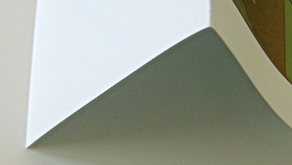 step 2 - Fold the printed card stock in half horizontally with a sharp crease.  Open the card flat to continue.
