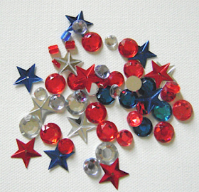 step 8 - Place red, blue, and clear rhinestones, beads and foil stars inside the container.  Allow them room to tumble around.