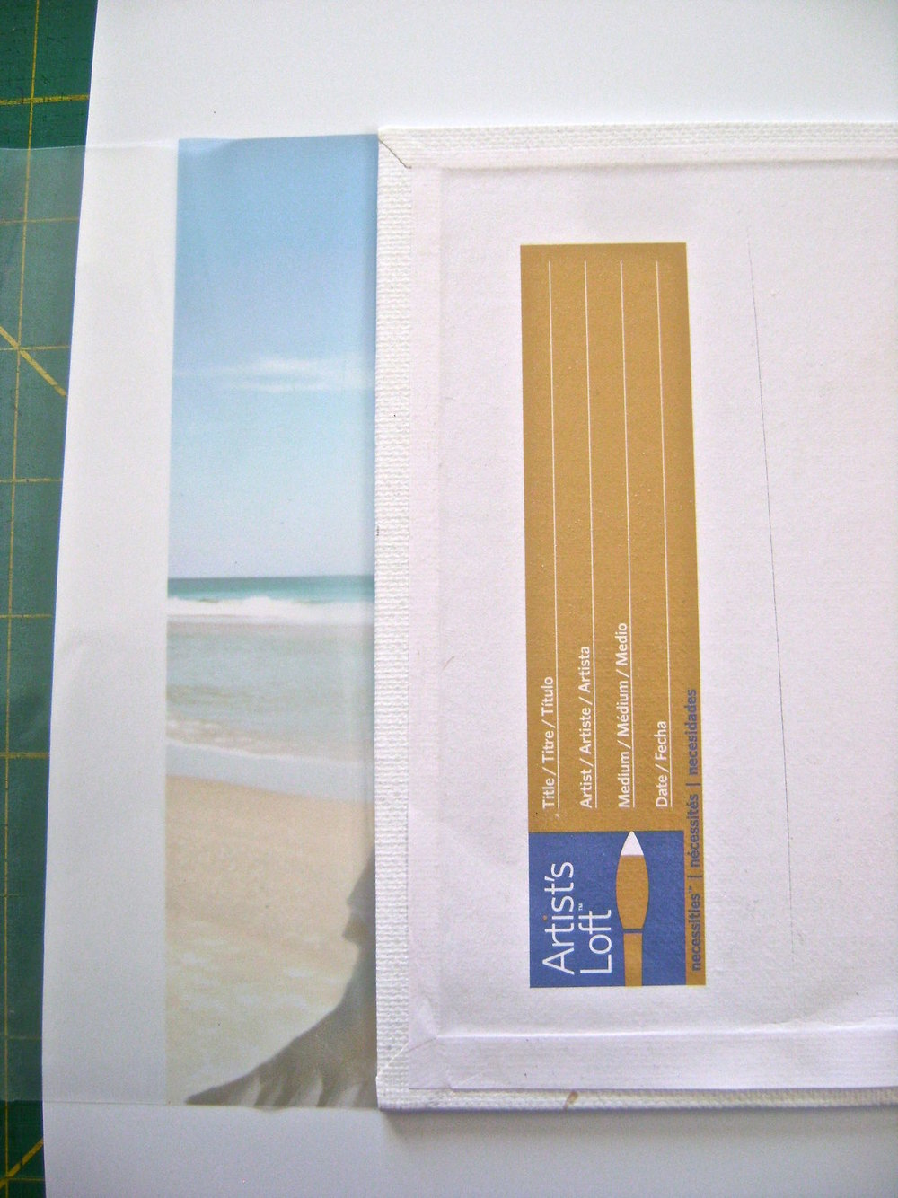 "step 10 - Spray adhesive on the flat 5"" x 7"" canvas. Apply adhesive to the back edges too. Align the second printed film to the top of the flat canvas as you did with the first image. Wrap the sides around to the back and press to secure it. Cut away excess."