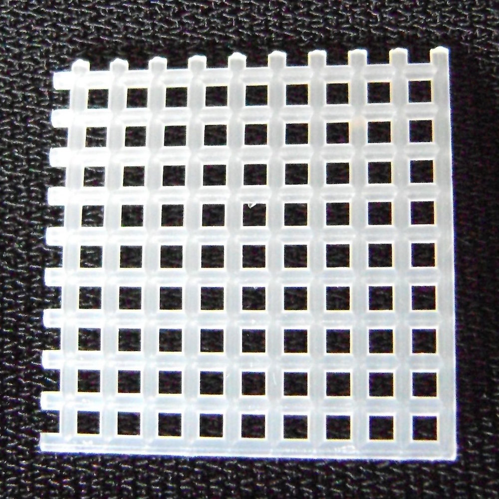 step 1 - Cut a one inch square of plastic mesh which will roughly be 9 holes.  Be sure there are as many squares vertically as there are horizontally.  This piece will be the foundation for the snowflake center and will be trimmed later.