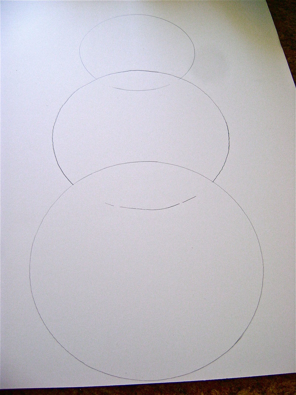 step 1 - The Snowman Lightly draw three different size circles on the foam board with a pencil, with each circle overlapping the one below it.