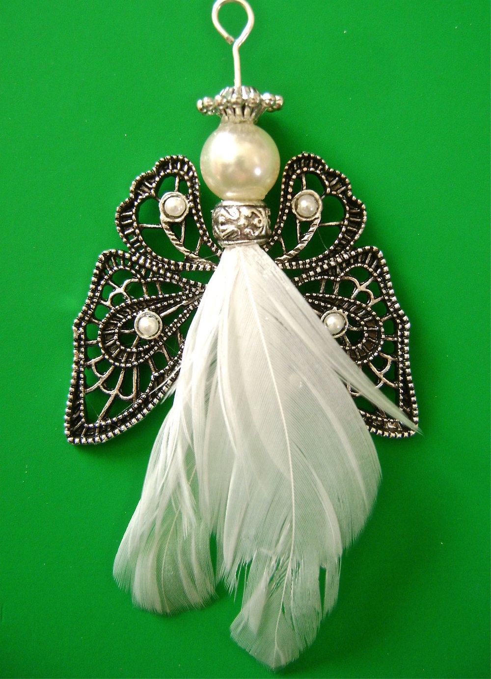 "Ornament measures 3"" long from the angel's crown to the feather bottom."