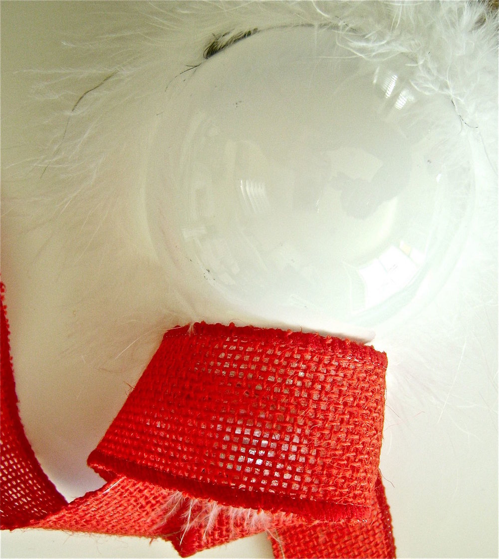 step 9 - Insert the bulb into the ribbon.  Place hot glue on the center back of the ribbon edge and hold it against the center back of the bulb.  Work your way around the scarf gluing it to the bulb.