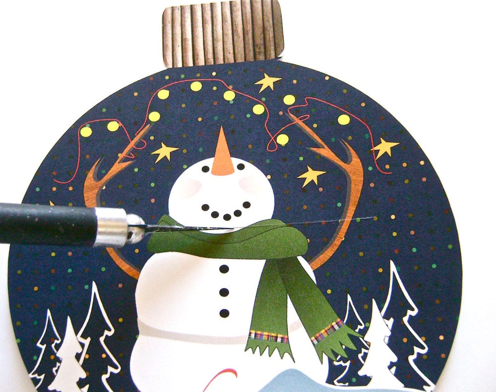 "step 3 - With a craft knife, cut a 2.50"" wide horizontal slit under the snowman's smile to insert the card.  Silhouette users skip this step."