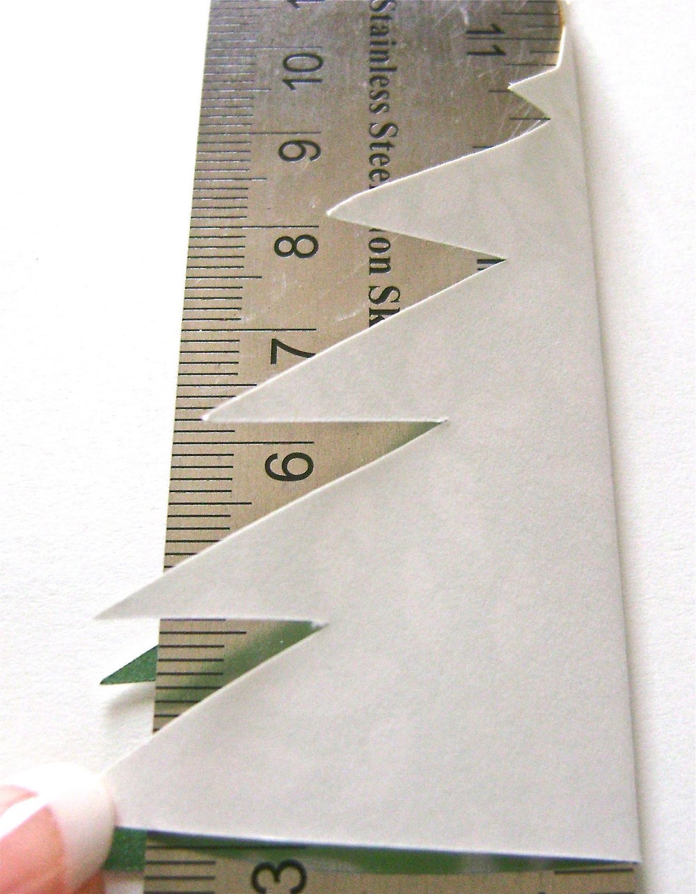 step 3 - Fold the tree against the ruler with printed sides together.