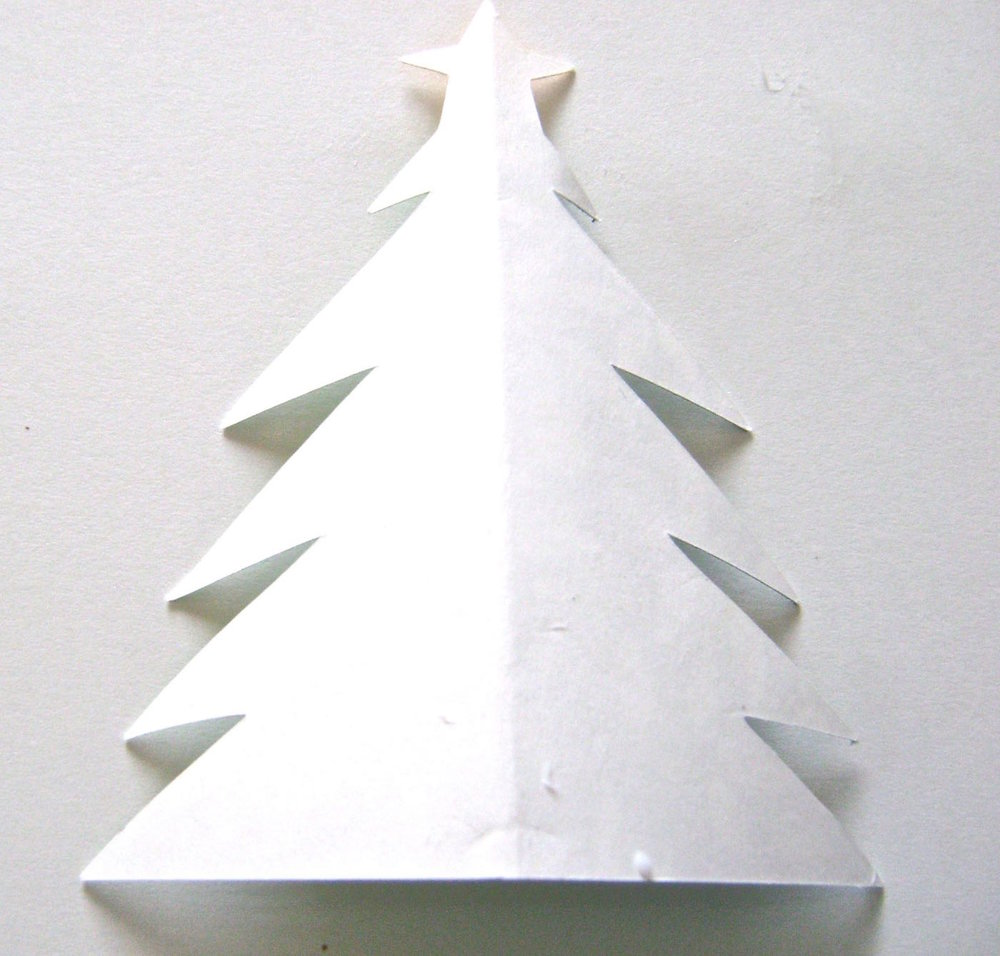 step 4 - Lay one tree flat on the work surface with the blank side facing you.  Apply glue to the blank side center and out to all edges.
