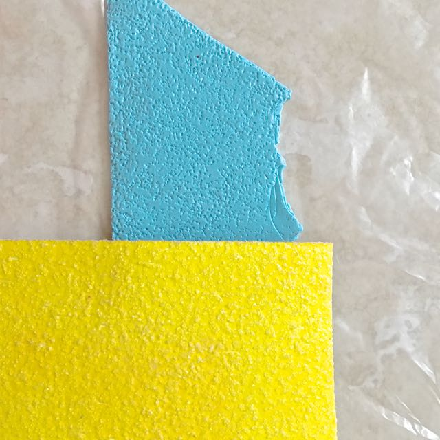 step 8 -  Texture and Paint the Clay  Press sandpaper or other similar texture onto a piece of turquoise clay.